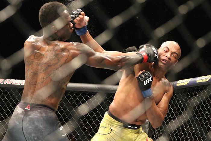 Hạ gục võ sĩ MMA xuất sắc nhất mọi thời, tay đấm bất bại gửi chiến thư tới toàn thế giới - Ảnh 8.