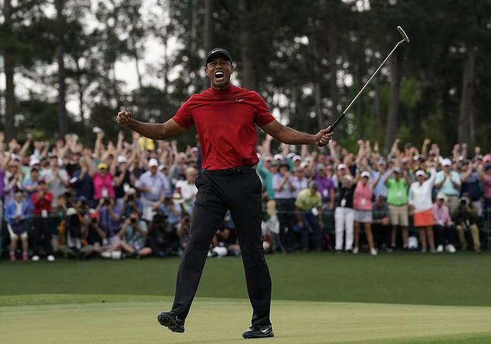 Tiger Woods chấm dứt cơn khát danh hiệu major kéo dài 11 năm bằng chiến thắng kịch tính - Ảnh 1.