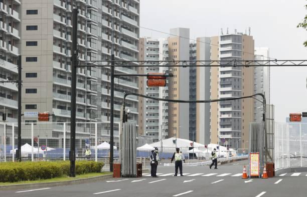 Làng vận động viên của Olympic Tokyo 2021 mở cửa trong ảm đạm - Ảnh 4.
