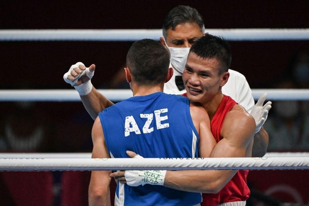 Tin cực vui tại Olympic: Võ sĩ boxing Nguyễn Văn Đương đấm ngã đối thủ, xuất sắc tiến vào vòng 1/8 - Ảnh 3.