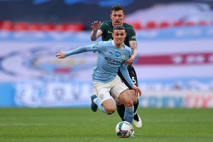 Man City đoạt chức vô địch đầu tiên mùa này nhờ khoảnh khắc tỏa sáng của cái tên bất ngờ - Ảnh 1.