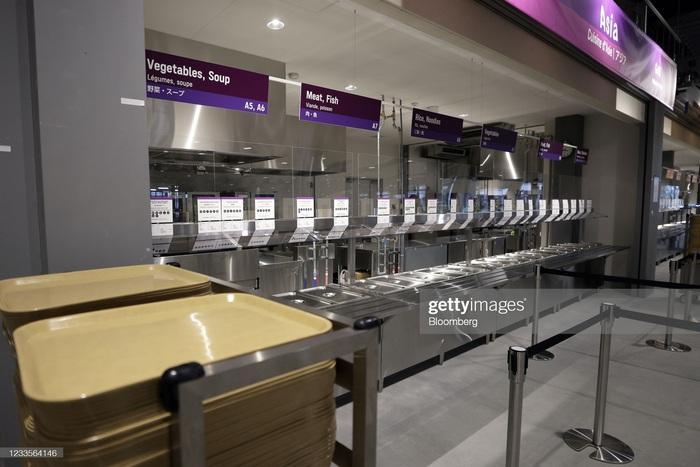 Làng vận động viên của Olympic Tokyo 2021 mở cửa trong ảm đạm - Ảnh 9.