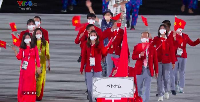 Tự hào hình ảnh Đoàn thể thao Việt Nam xuất hiện ở lễ khai mạc Olympic Tokyo 2020 - Ảnh 1.