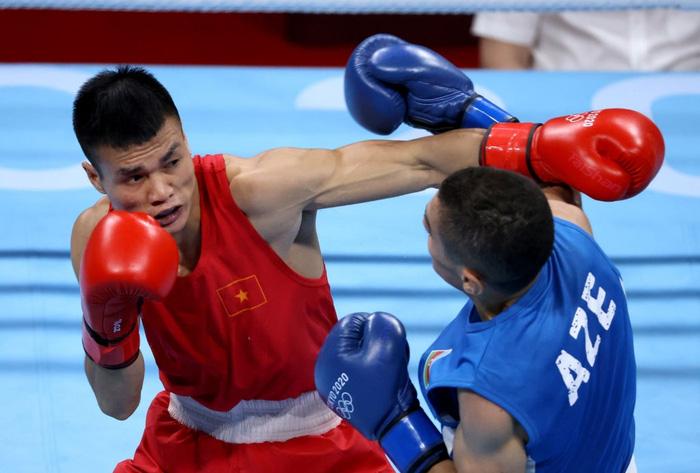 Ảnh: Nguyễn Văn Đương vượt qua đối thủ mạnh, giúp boxing Việt Nam có chiến thắng lịch sử sau 33 năm - Ảnh 3.