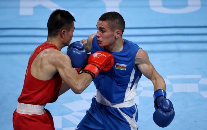 Ảnh: Nguyễn Văn Đương vượt qua đối thủ mạnh, giúp boxing Việt Nam có chiến thắng lịch sử sau 33 năm - Ảnh 2.