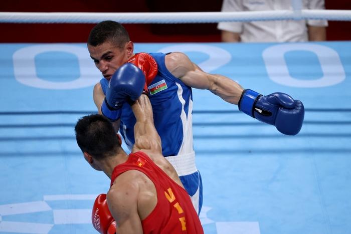 Ảnh: Nguyễn Văn Đương vượt qua đối thủ mạnh, giúp boxing Việt Nam có chiến thắng lịch sử sau 33 năm - Ảnh 5.
