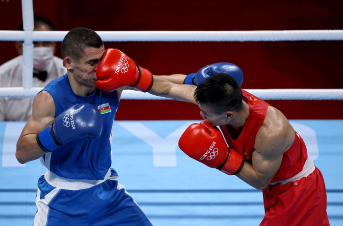 Ảnh: Nguyễn Văn Đương vượt qua đối thủ mạnh, giúp boxing Việt Nam có chiến thắng lịch sử sau 33 năm - Ảnh 6.