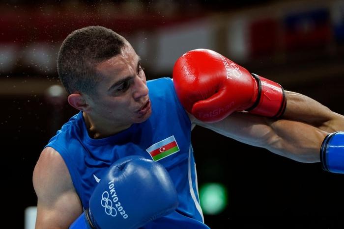 Ảnh: Nguyễn Văn Đương vượt qua đối thủ mạnh, giúp boxing Việt Nam có chiến thắng lịch sử sau 33 năm - Ảnh 7.