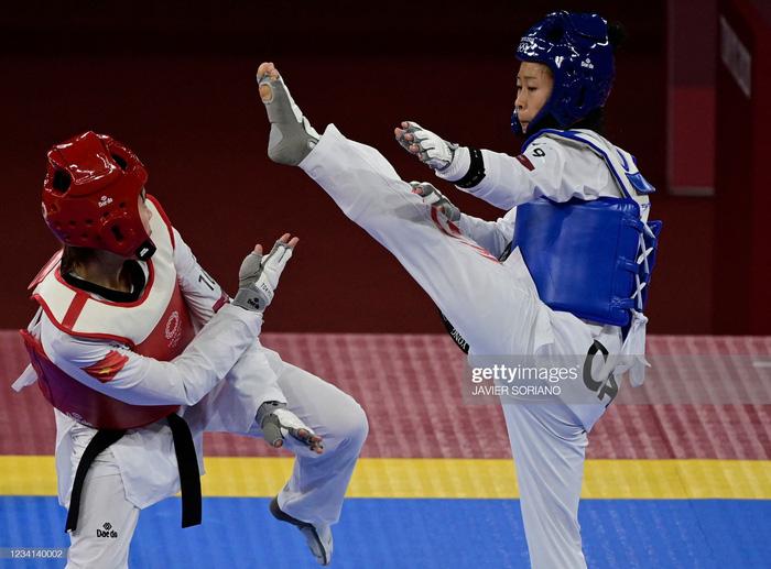 """Trương Thị Kim Tuyền """"lấy nhu thắng cương"""" đả bại đại diện Canada trận ra quân Taekwondo Olympic Tokyo 2020 - Ảnh 7."""