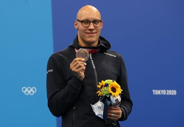 Tấm huy chương Olympic sau 101 năm và câu chuyện truyền cảm hứng của VĐV mắc bệnh hiếm khiến đầu trọc lốc - Ảnh 1.