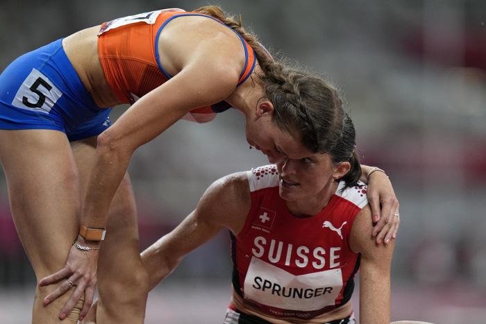 Ảnh Olympic Tokyo 2020: Sự tử tế, lòng đồng cảm tạo nên kỳ Thế vận hội đầy nhân văn - Ảnh 13.